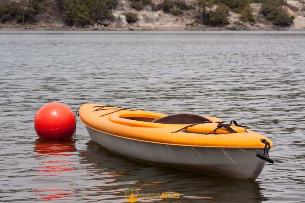 an anchored kayak to show How To Anchor A Kayak without a Trolley