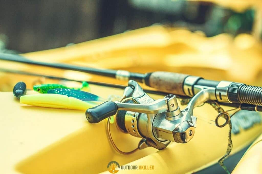 Kayak with rod to show how to fish for trout in a kayak