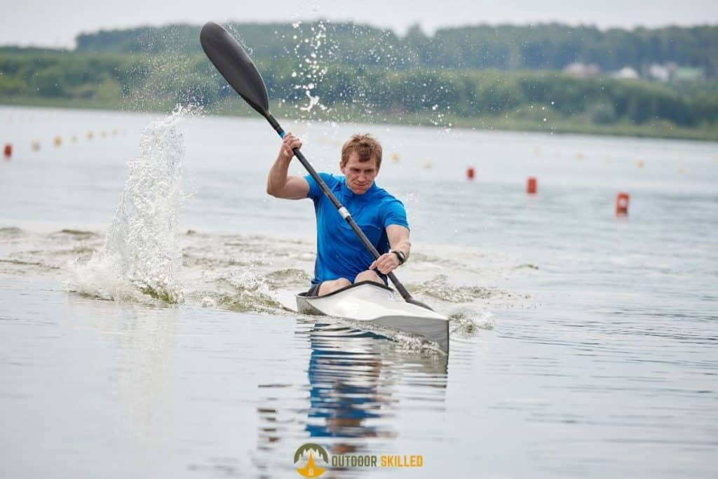 man kayaking to show what makes a kayak track straight